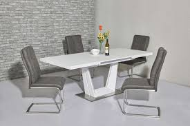 matt white glass dining table and 8 chairs