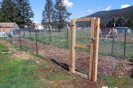 putting up fence and building a gate