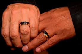 gay wedding bands for men. file ** in this file photo from june 17, 2008, eric manriquez, left, and juan rivera hold their gold wedding rings together as they get married east los gay bands for men