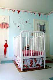 This week I thought it would be fun to take a peek at another nursery. The  twist? Those pretty robin's egg blue walls belong to a little girl!
