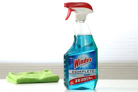 glass cleaner next to green towel by windex window outdoor kit