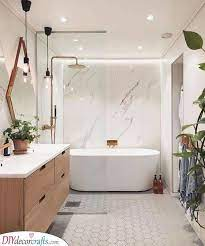 This small space bathroom features many small space tricks, including the perfect combination of mirror and glass. Bathroom Design Ideas Best Bathroom Designs Diy Deco Crafts Home Decor Diy Gift Diy Craft Ideas Diy Ideen Deko Ideen