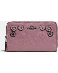 COACH - Medium Zip Around Wallet With Hearts - Lyst