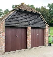 cottage garage doorsGarage Doors  Anglian Home Improvements