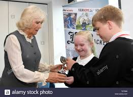 The Duchess of Rothesay presenting the winning trophy to junior journalists Ava  Duncan and Finlay Mannion of Culter School during a visit to the Aberdeen  Journals office in Marischall Square, Aberdeen Stock