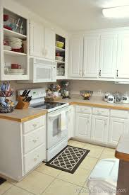 and here s how it looked after we installed our new laminate countertops we custom ordered at home depot and did a diy beadboard backsplash