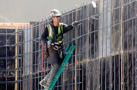 ironworker fidel camacho ties rebar for a ground floor wall pour at the lower burnside rebar worker