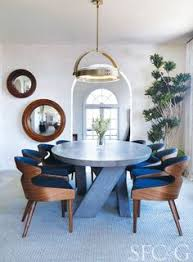 a modern dining room designed in a blue color palette with a custom bausman pany