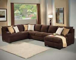 living room ideas with brown sectionals. A Large Chocolate Sectional Sits Atop Matte Gray Floor. An Ivory Area Rug Breaks Living Room Ideas With Brown Sectionals N
