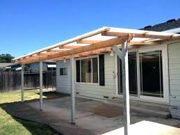 attach roof over deck from house large size of wood awning plans over a door retractable