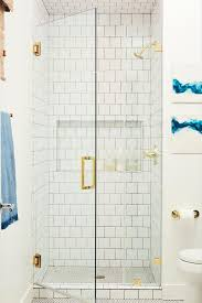 contemporary bathroom with clean white tile shower