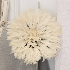 juju hat feather wall hanging by raw decor