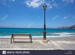 bench lighting. A Bench And Lamp Post Over Looking Mirabellow Bay, Crete - Stock Image Lighting