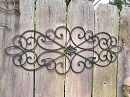 cast iron wall art outdoor metal decor awesome good wrought for your medium size of sculpture chrome bird branch