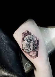 stained glass flower tattoo by m x m