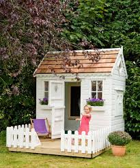 front view with door and window boxes of childrens garden playhouse