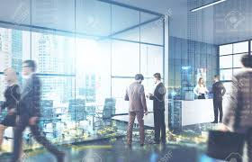 suits office. Men And Women In Suits Walking A Glass Office. City View Is Seen On Office E