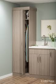 ironing board cabinet Laundry Room Modern with cabinets cleaning clothes  clothing. Image by: Closet Classics of Andover