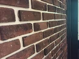 installed brick veneer on drywall and
