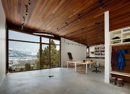 open space home office. garden beside carney logan burke among plank wall also large glass window under that allow you open space home office