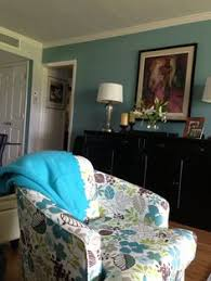 our color palette for the condo came from this chair we used behr bon voyage aqua paintpaint colorsliving room