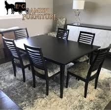 this beautifully custom made solid wood amish dining table and chairs set with custom fabric is the perfect addition