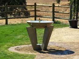 interesting modern bird bath feeder design with iron plat tiered