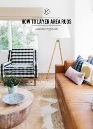 Multiple Rugs In Living Room How To Perfect The Layered Rug Look The Everygirl