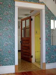 the author moved this original four light exterior door from the back wall of his