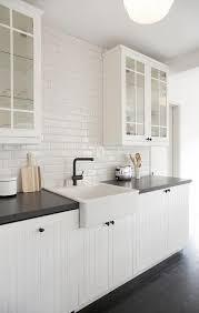 white beadboard kitchen cabinets with beveled subway backsplash tiles