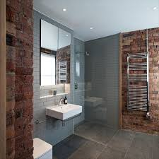 Example of a trendy gray tile and subway tile corner shower design in  London with a