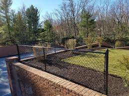 black chain link fence on a basketball court retaining wall