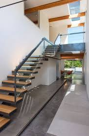 Contemporary Staircase with Floating staircase, Concrete floors