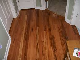 amazing entryway applying laminate harwood flooring tile in brown color combined with green wall color and