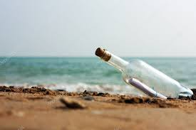 letter in a bottle message in a bottle stock photo borojoint 4631444