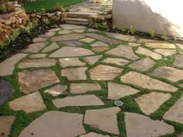 diy flagstone patio over concrete. a patio should be more than bald square of concrete poured behind the back door. diy flagstone over