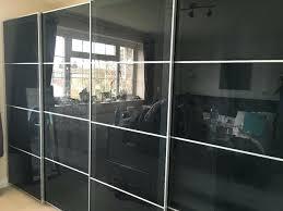 grey fitted wardrobes ikea 2 x double sliding wardrobes 4 x grey black smoked glass sliding