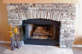 classic stacked stone wood burning fireplace ideas with antique candle holder as rustic living areas decorating designs