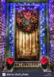 How To Hang Lighted Wreath On Door Lighted Christmas Wreath On Wood Door With Blue Light Trim