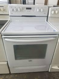 amana white glass top stove