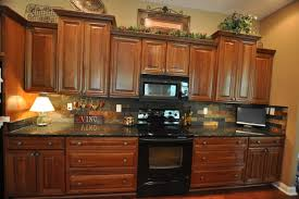uba tuba granite with brick stagger tile backsplash contemporary kitchen