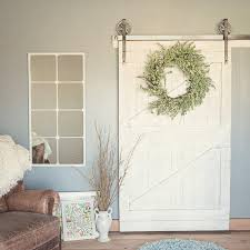 white barn door. A Pure White Barn Door With Industrial Metal Hardware Is The Perfect Addition To Shabby