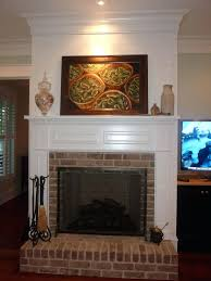 wooden mantel over brick fireplace wood mantels raised hearth paneling