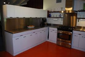 mid century modern kichen renovation photo of refinished 1950s metal cabinets