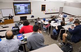 alumna finds success as 101 5 news anchor brookdale community students and members of the history and political science club sit in on a presentation by