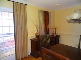 By painting above the chair rail and below the chair rail the same color,  the room looks bigger. Our custom drapes, (hung just below the ceiling)  make the ...