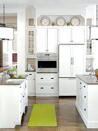 ideas for decorating above kitchen cabinets not sure what to do with that awkward top of top of cabinet decor ideas decorating over kitchen cabinets