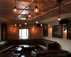 decorative exposed bulbs create a warm glow inside our edom industrial cage pendant lights