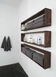 fix this build that made these incredible diy floating shelves from firewood yep plain ol firewood they win most creative wall shelf project