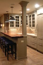Bar Top Ideas Basement kitchen island with raised bar | plank style walnut  counter with